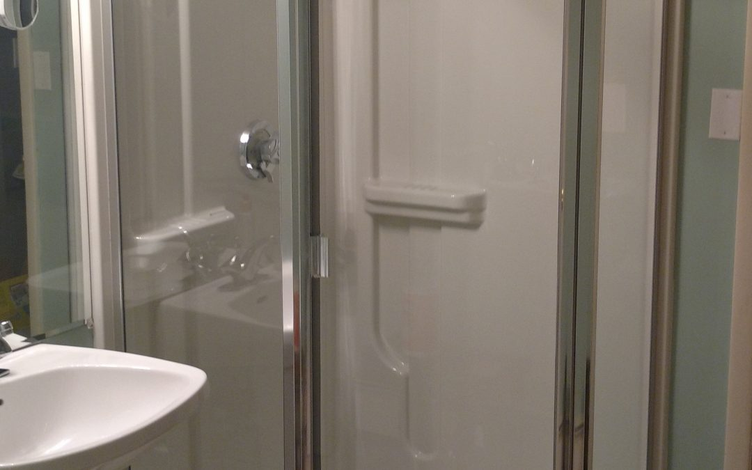 Semi-frameless neo angle shower door with 1/4″ thick glass