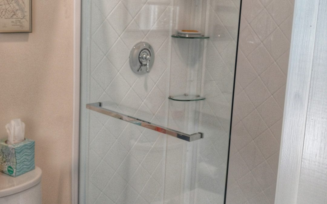 Modern splash panel with clear glass and chrome hardware