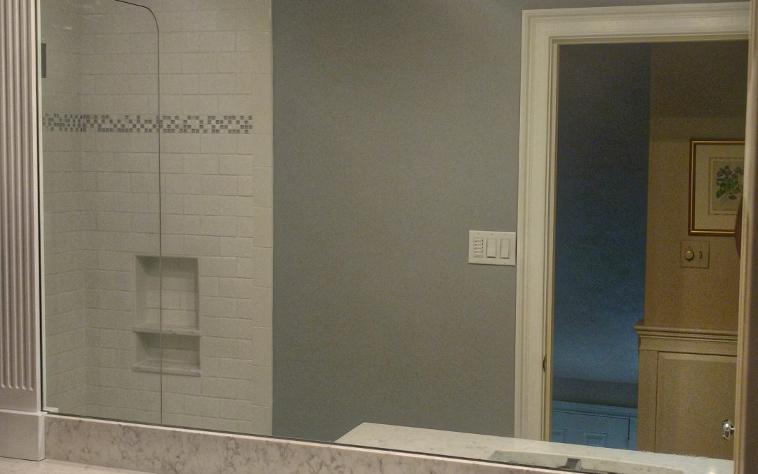 Mirror from vanity to ceiling. Installed in Peabody.