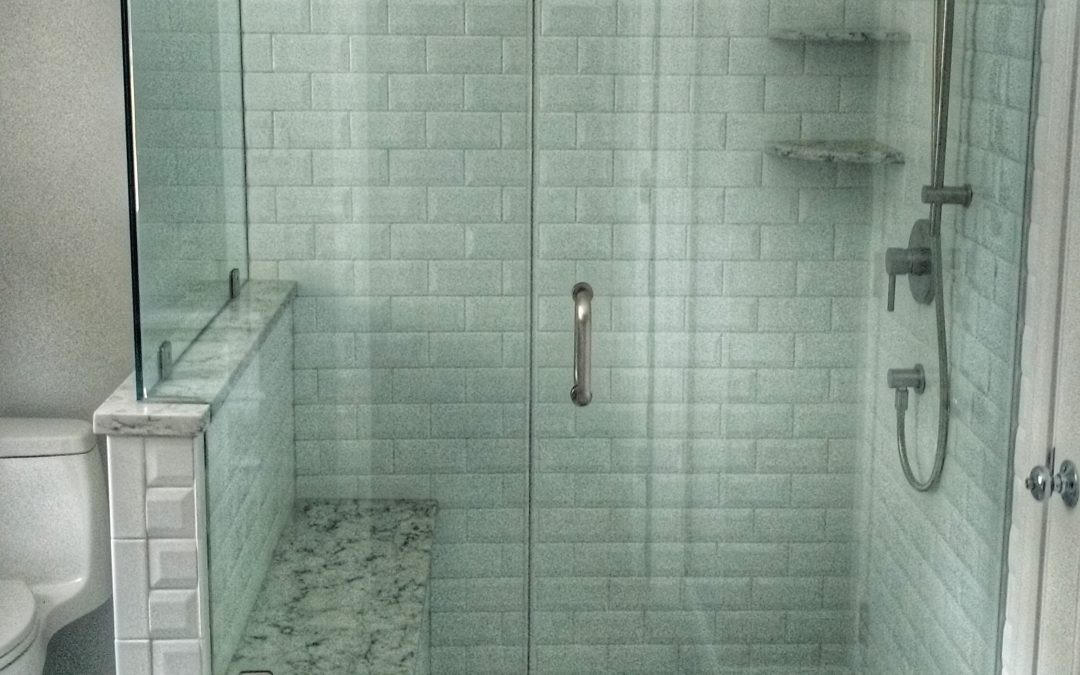 Frameless shower with perfect double notched panel and brushed nickel hardware
