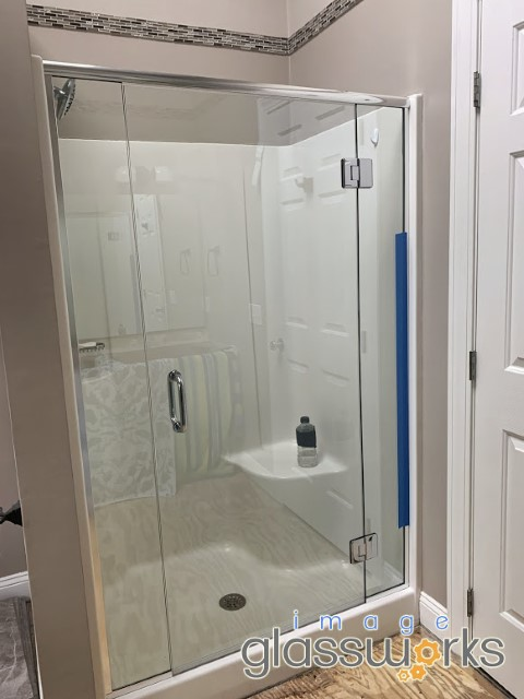 3-panel frameless shower enclosure with header